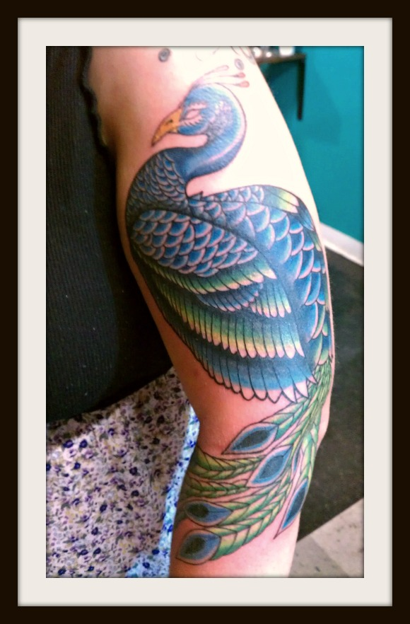 peacock tattoo arm sleeve
